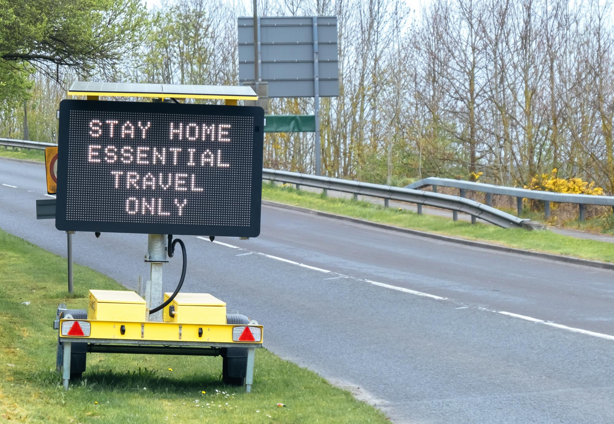 Sign tells motorists to stay at home, essential journeys only.