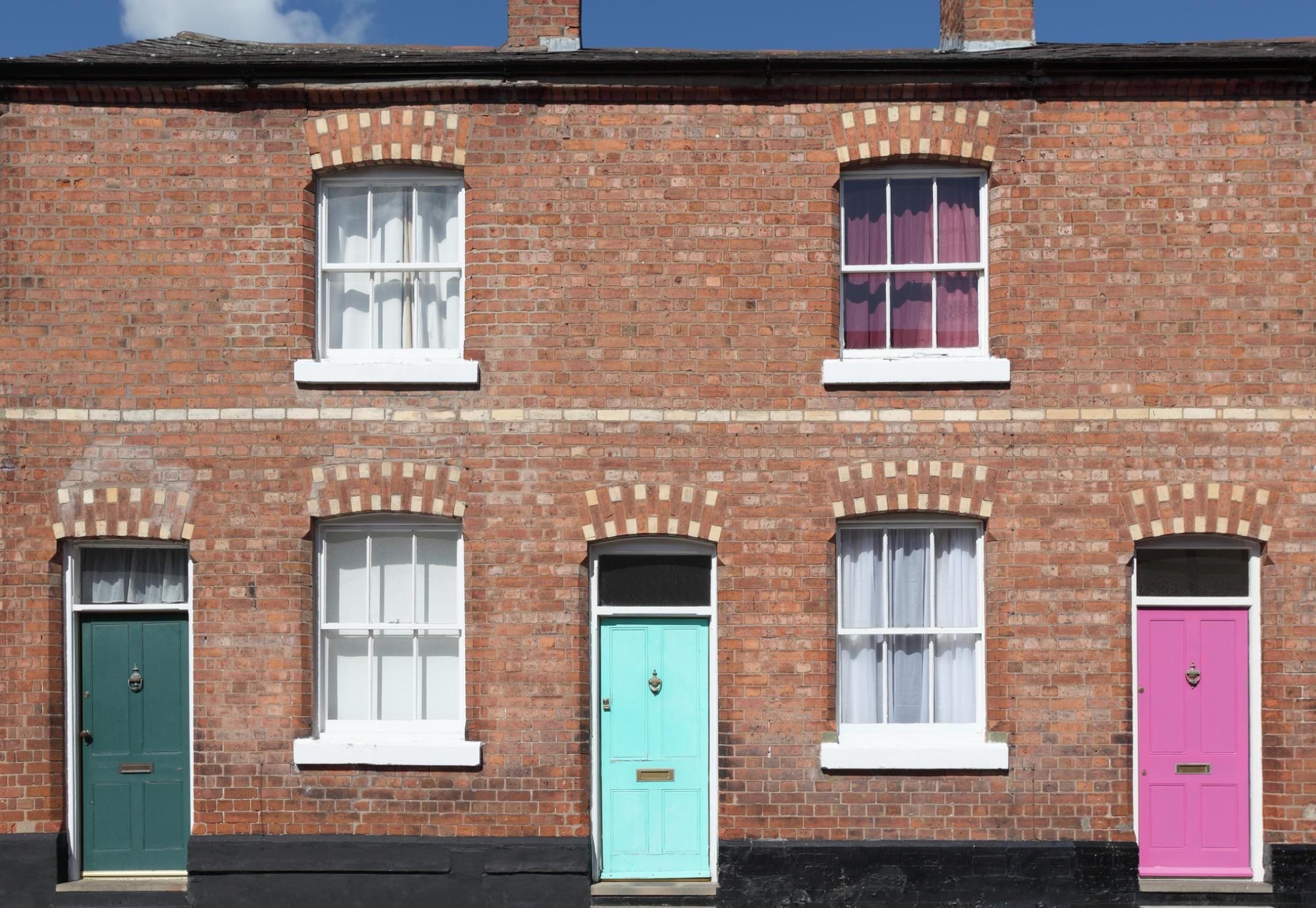 Terraced houses with multicoloured doors.