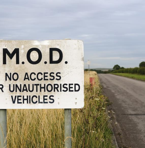 Sign warning public that a road belongs to the MOD and is private.