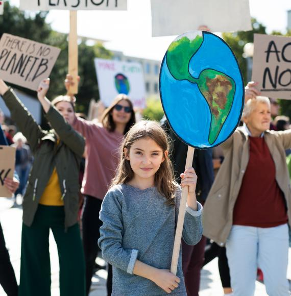 People with placards and posters on a global strike for climate change.