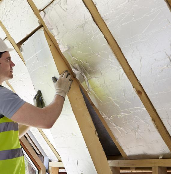 Insulation being fitted in a wall