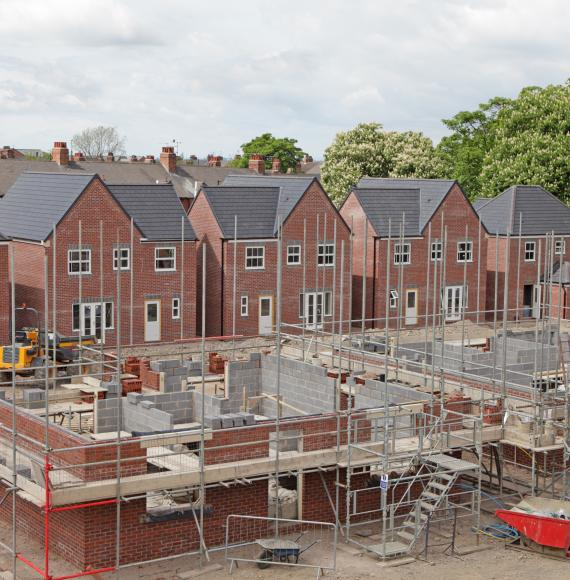 Houses being built on a construction site
