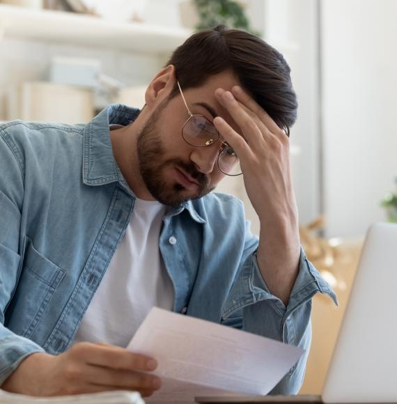 Man looking concerned at rent bill