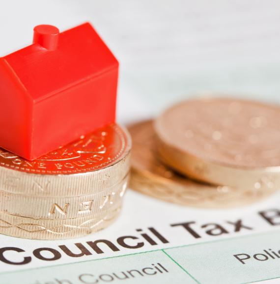 Council tax bill with coins on top.