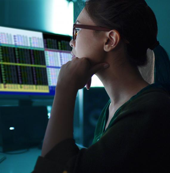 Woman sat at a computer analysing data
