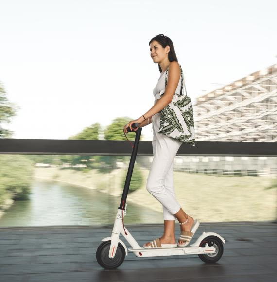 Woman rides an e-scooter