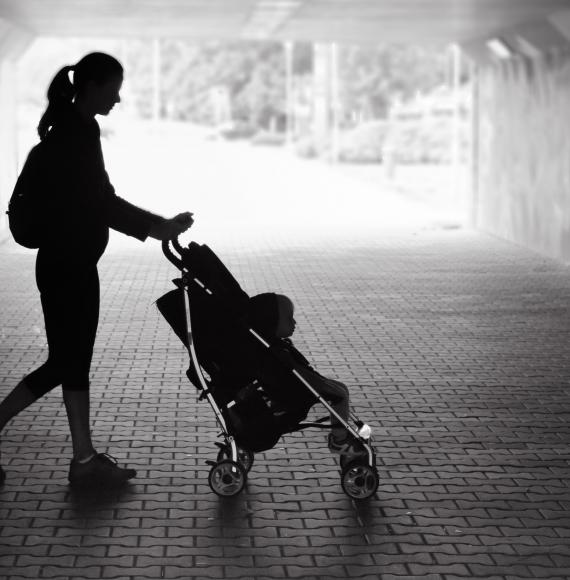Black and white picture of single mum with pram.