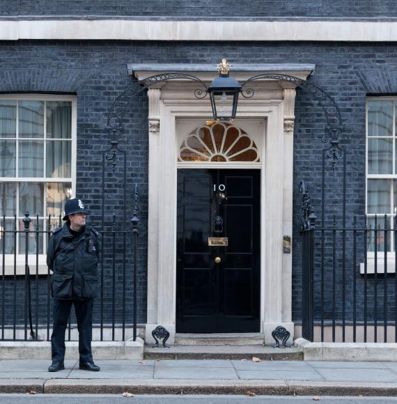 Policeman stands guard outside 10 Downing Street.