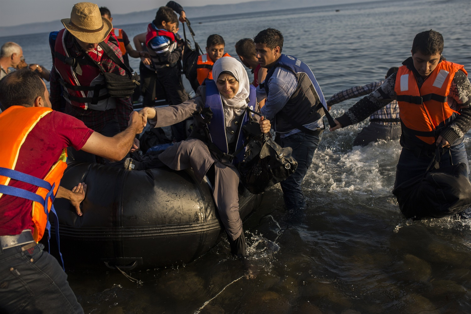 Migrants from Syria, Afghanistan arrive on Lesbos. July 15. AP Photo, Santi Palacios