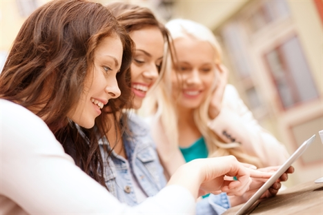girls looking at tablet pc